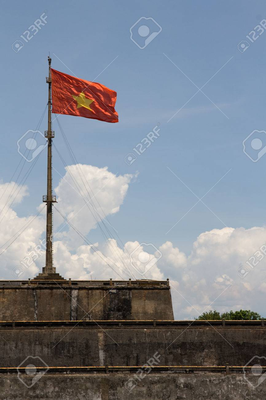 Vietnam flag standing on flag pole above historic hue citadel vietnam flag standing on flag pole above historic hue citadel wall stock photo 50285591 sciox Image collections