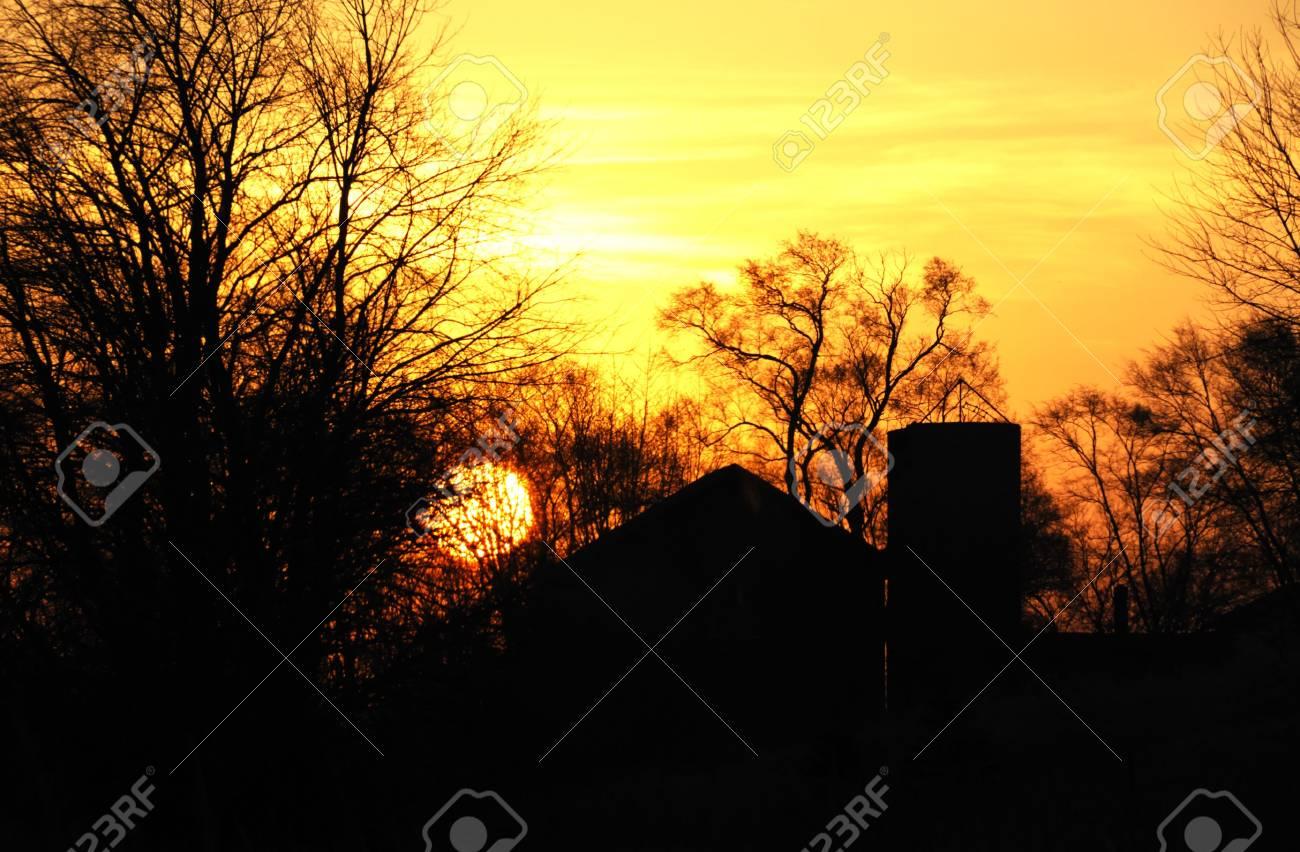 Barn and Silo Silhouette at Sunrise Stock Photo - 4724261