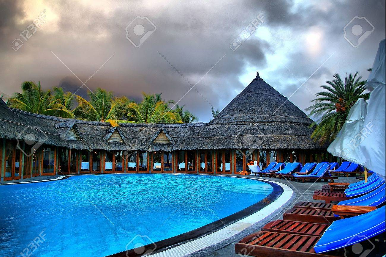 Large tropical outdoor swimming pool HDR image