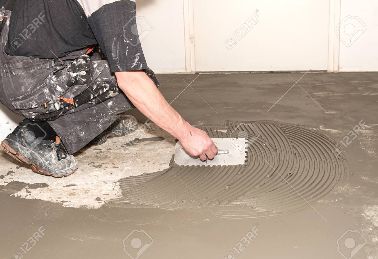 Nice 1 Inch Hexagon Floor Tiles Thin 12 X 24 Ceramic Tile Square 12X12 Ceiling Tiles Home Depot 1930S Floor Tiles Old 2 X 6 Subway Tile Backsplash Blue3X6 Travertine Subway Tile Worker Applied Adhesive For Ceramic Tiles In Construction Stock ..