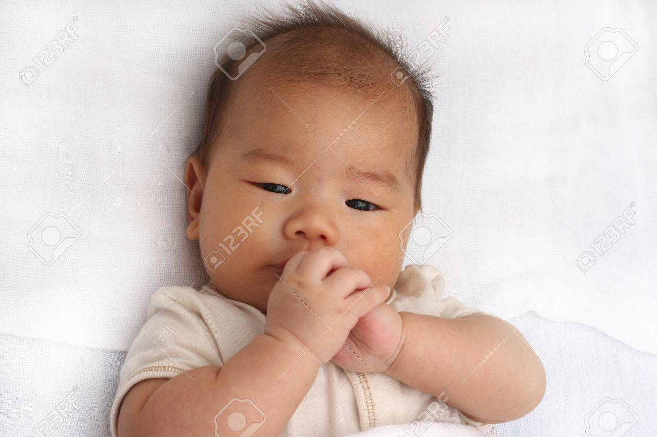 Asian baby playing with hands Stock Photo - 8698678