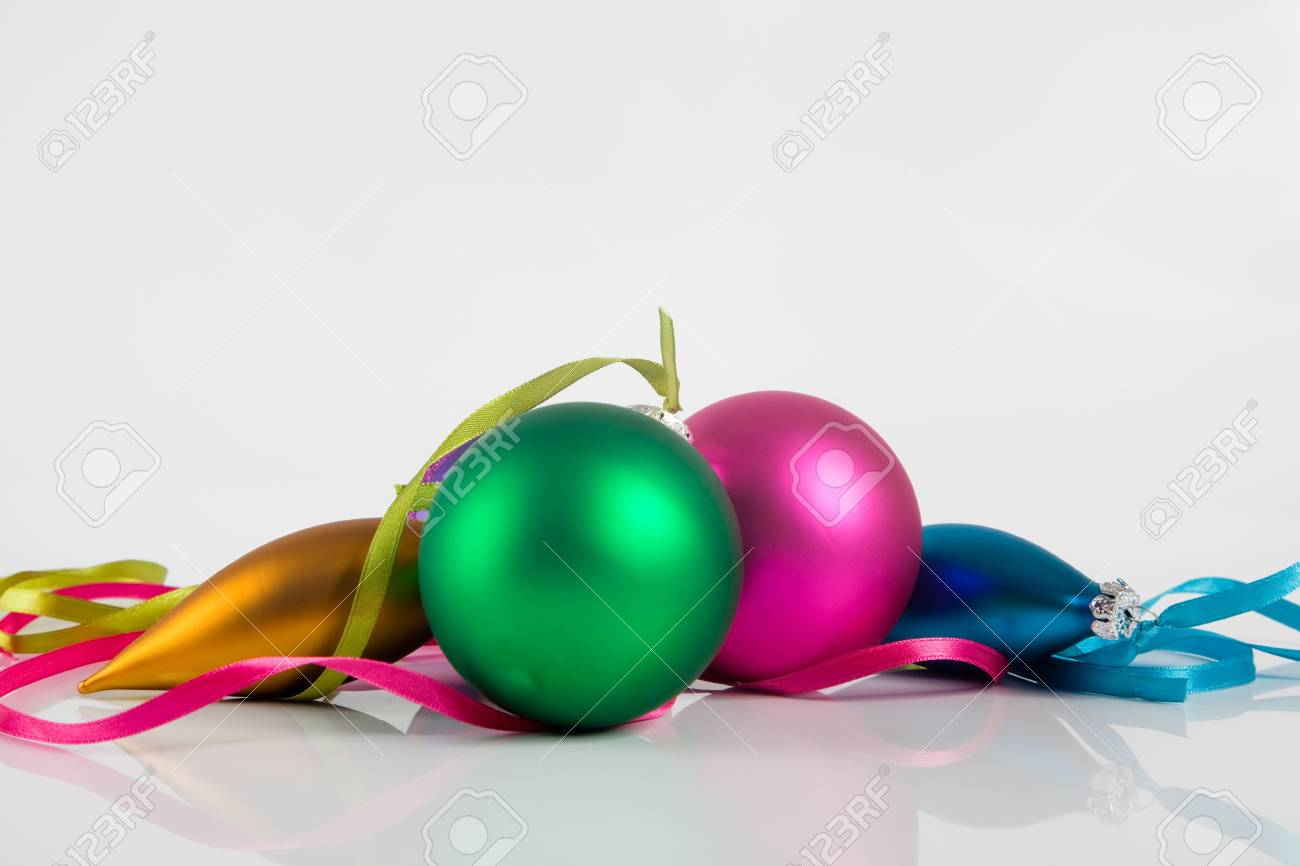 Different colored christmas ornaments on white background Stock Photo - 5794801