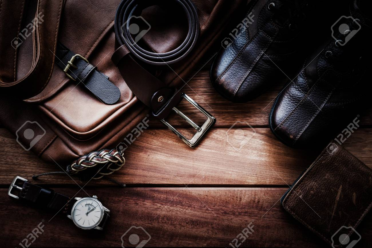Men's leather accessories on rustic wooden background, fashion and beauty, travel concept - 86050259