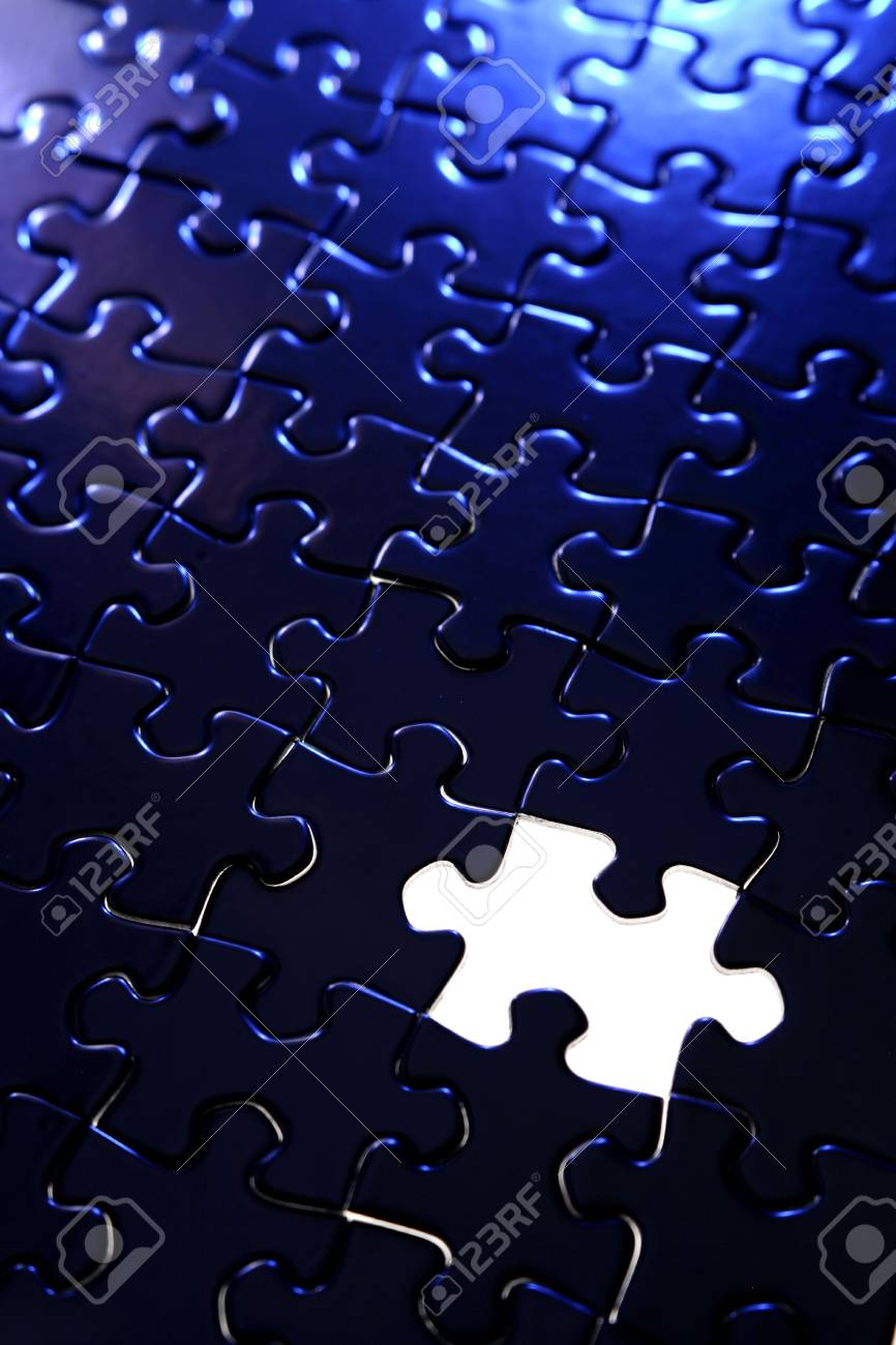 Piece missing from jigsaw puzzle Stock Photo - 2409736