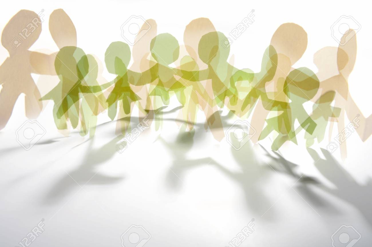 Paper Doll Cutouts Symbolising Overcrowding Or Unity Stock Photo