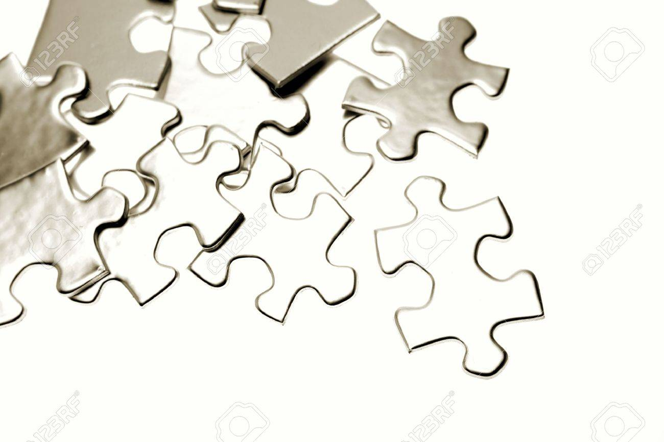 Jigsaw puzzle pieces on white Stock Photo - 5832797
