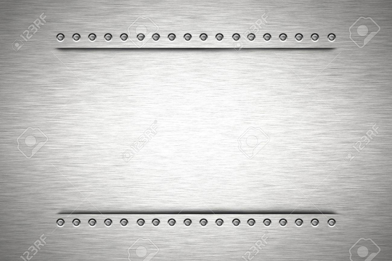 Rivets in brushed steel background. Copy space Stock Photo - 6196798