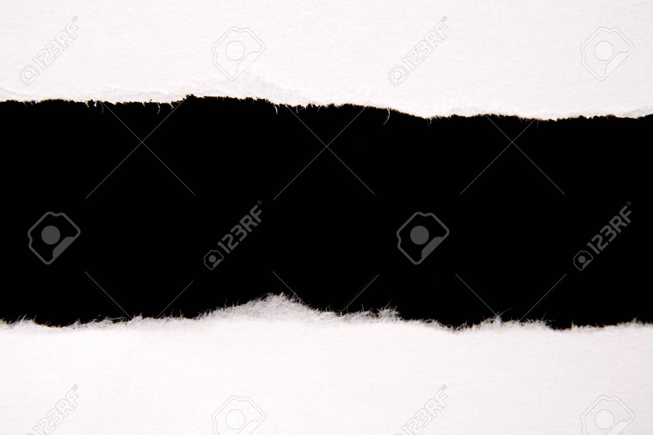 Hole ripped in white paper on black Stock Photo - 7581770