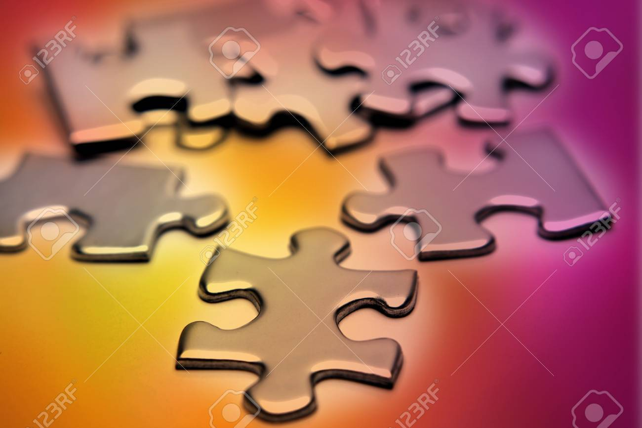 Jigsaw puzzle pieces scattered on color background Stock Photo - 7733345