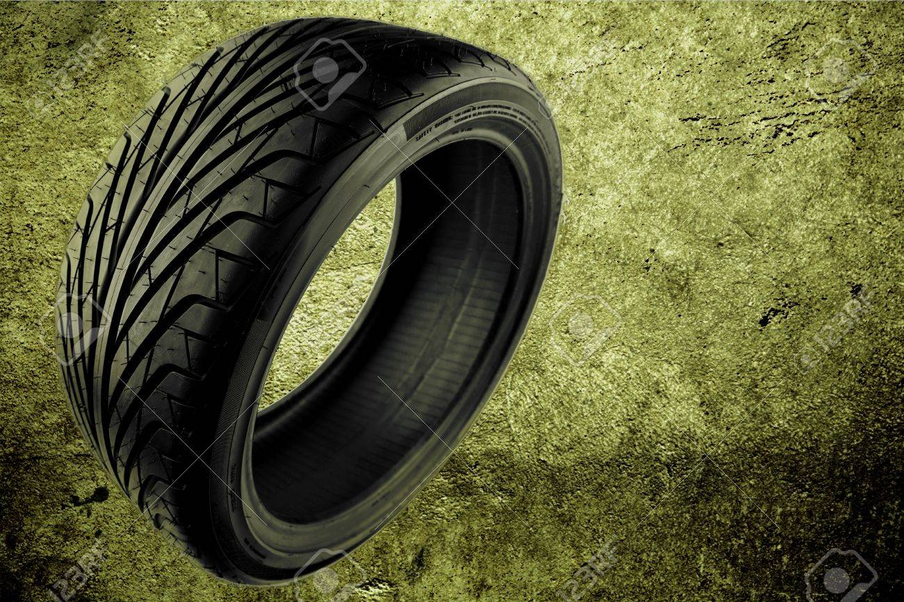 Rubber auto tyre on abstract background Stock Photo - 7733457
