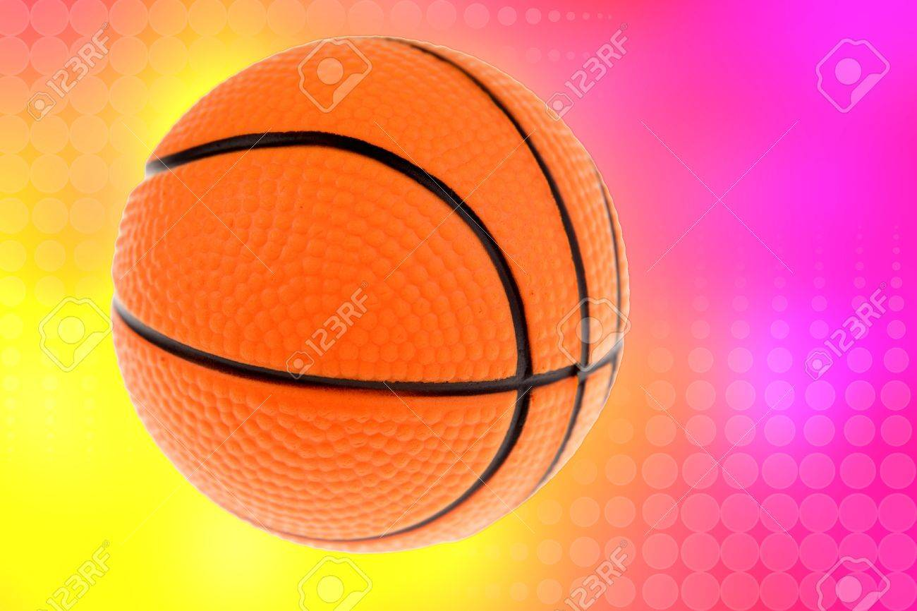 basketball on yellow and pink color background stock photo
