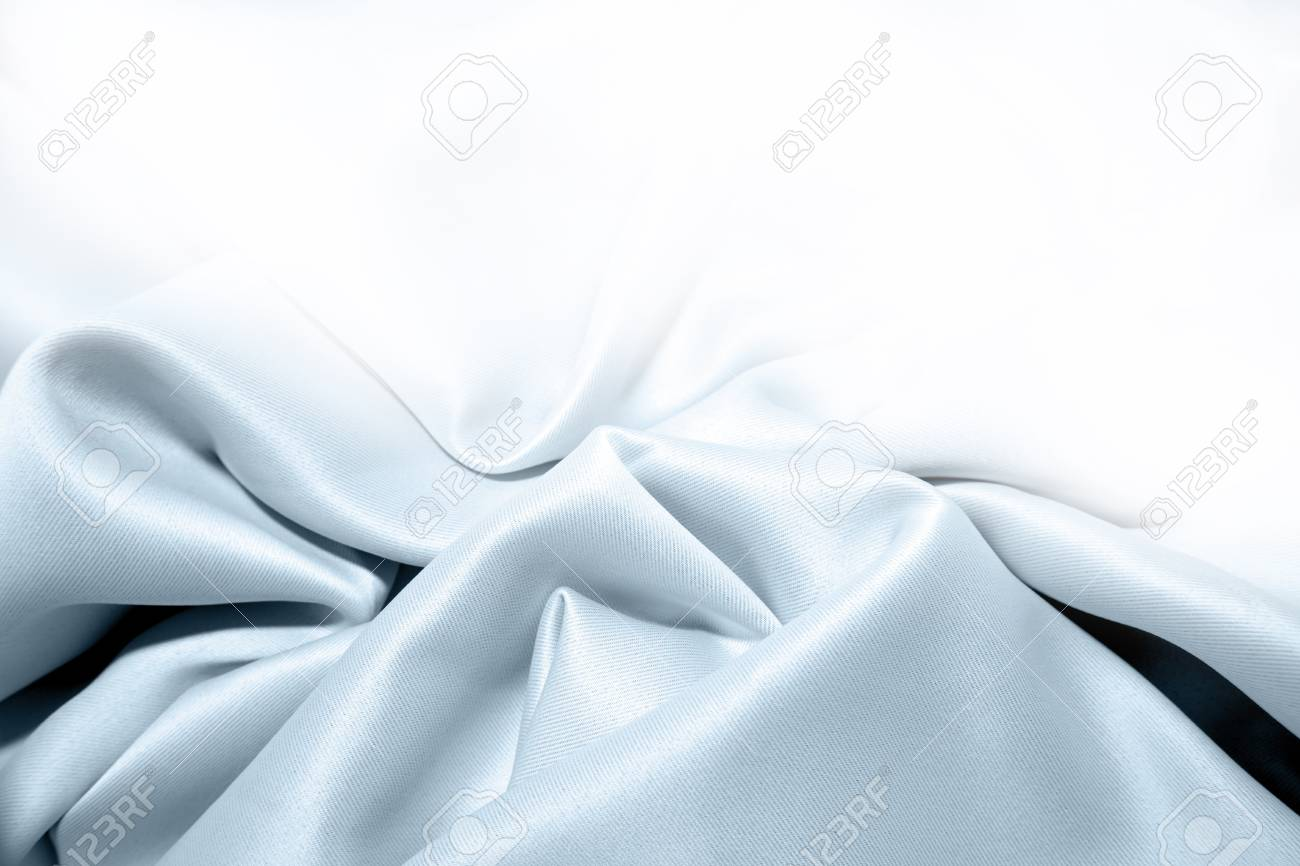 Blue silk fabric on white background. Copy space Stock Photo - 8752856