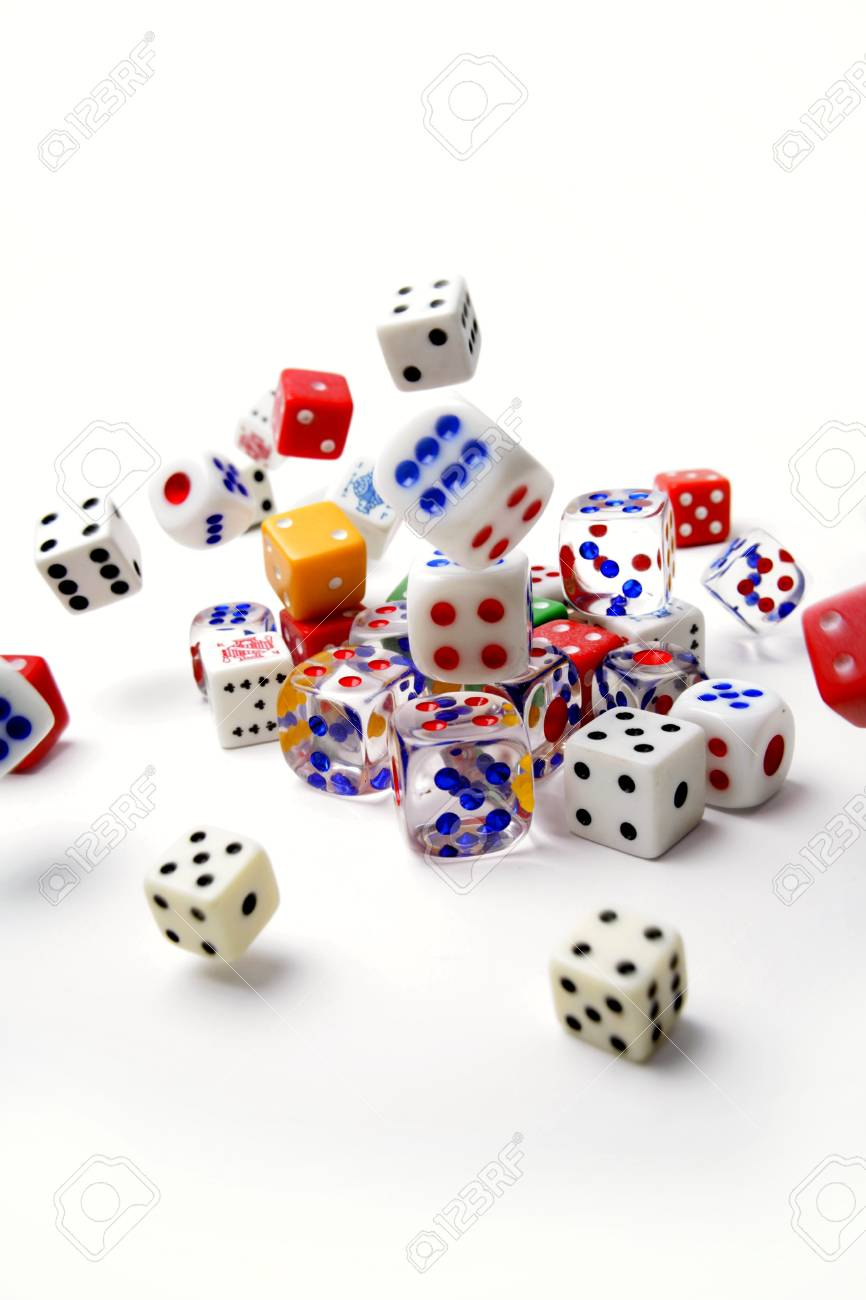 Dice rolling on plain background Stock Photo - 9569901
