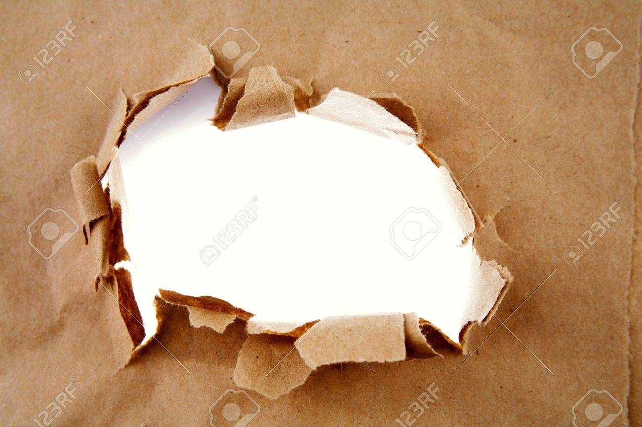 Hole ripped in brown paper Stock Photo - 9570361