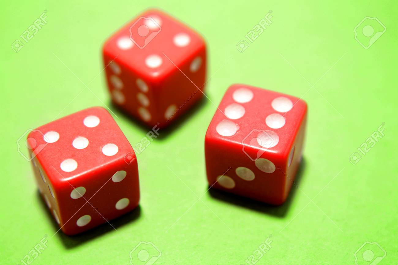 Three dice on green background Stock Photo - 12523011