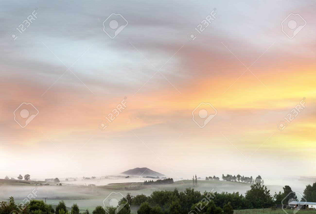 Beautiful sunrise over foggy farmland Stock Photo - 12877216