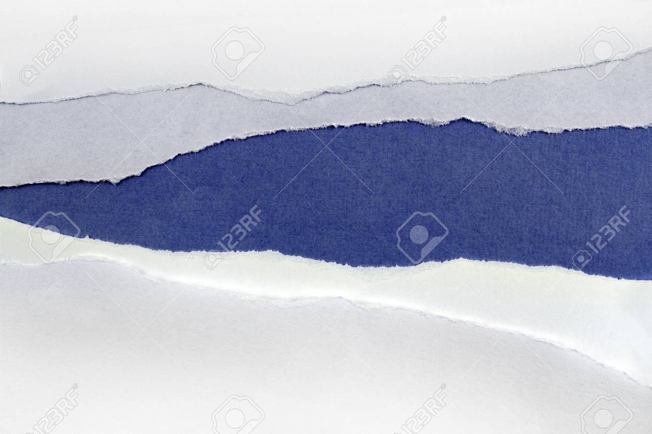 Hole ripped in white paper on blue background Stock Photo - 12931065