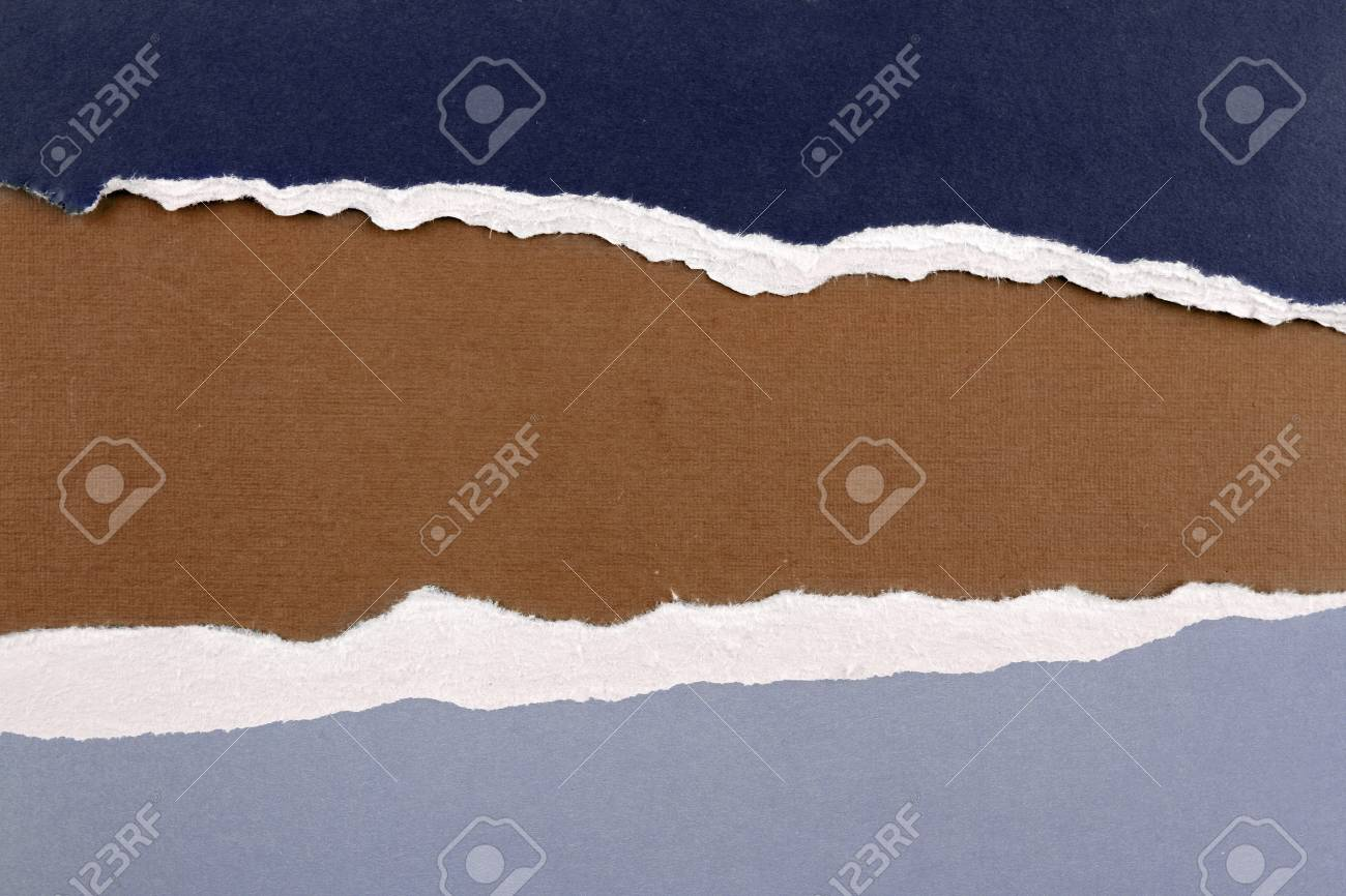 Hole ripped in paper on brown background. Copy space Stock Photo - 12970535
