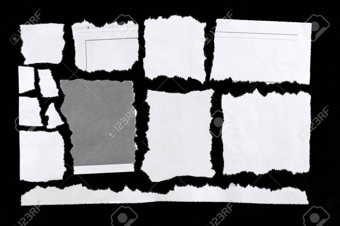 Torn pieces of paper on black background Stock Photo - 13488244