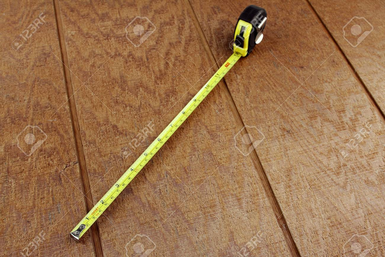 Tape measure extended on wooden surface Stock Photo - 13784478