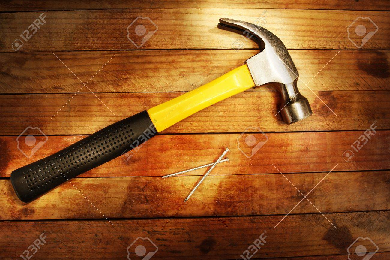 Hammer and nails on wood Stock Photo - 13852311