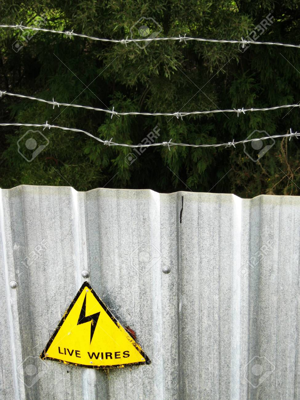 Sign on barbed wire security fence Stock Photo - 13995302