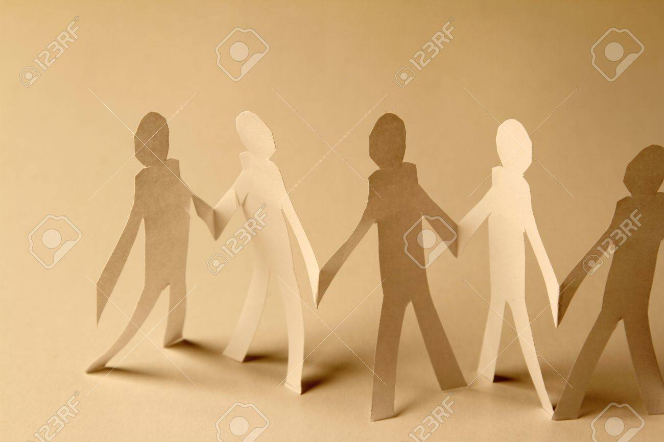 Paper Doll Cutouts Holding Hands Stock Photo