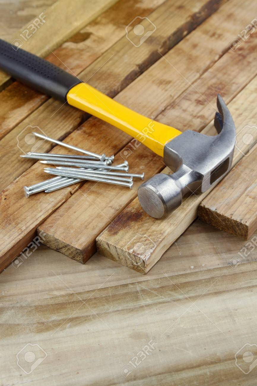 Hammer, nails and pieces of wood Stock Photo - 14029661