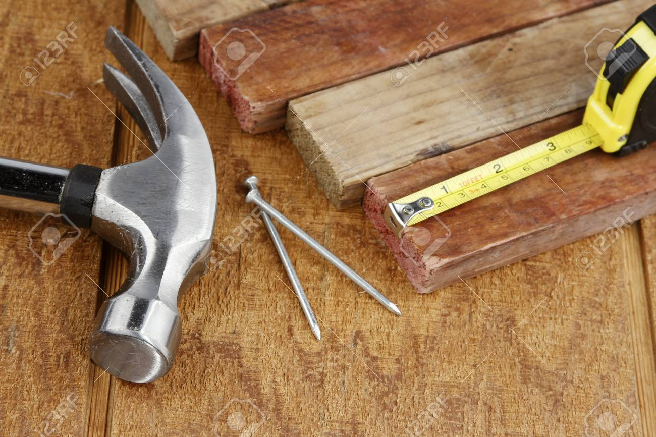 Hammer, nails, tape measure and pieces of wood Stock Photo - 14695222