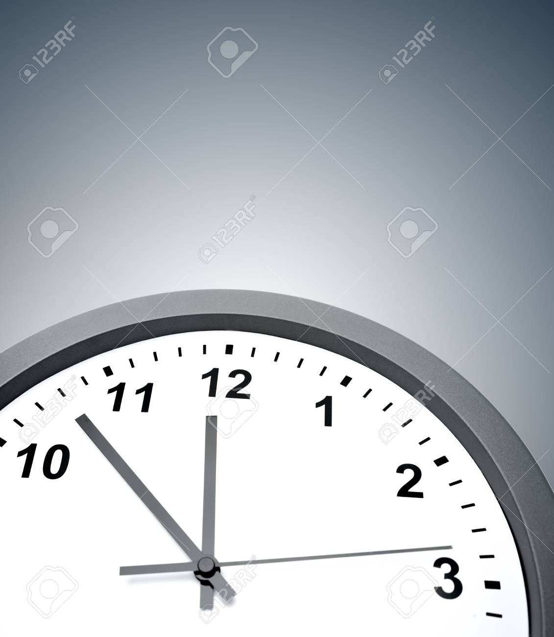 Closeup of clock on grey background Stock Photo - 17361028