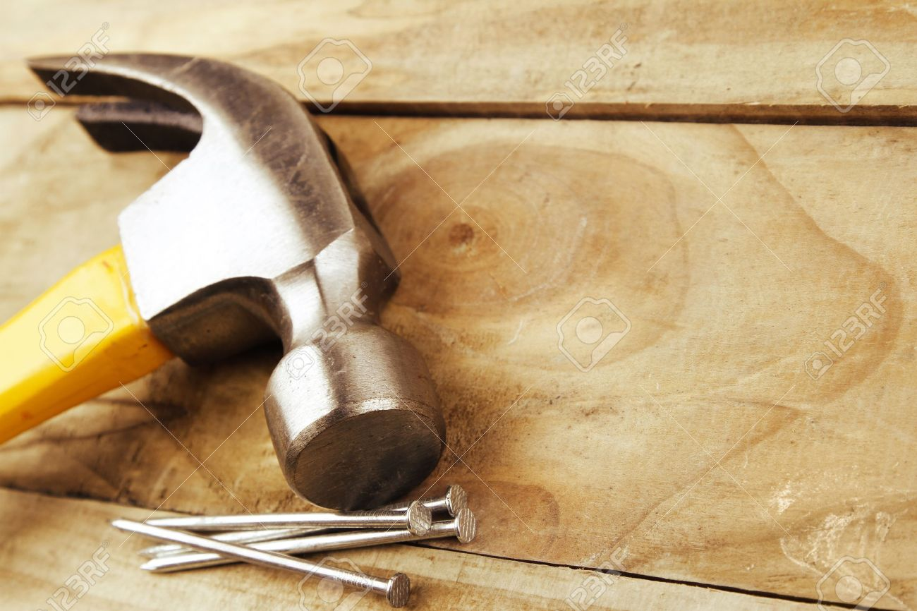 Hammer and nails on wood Stock Photo - 18308005