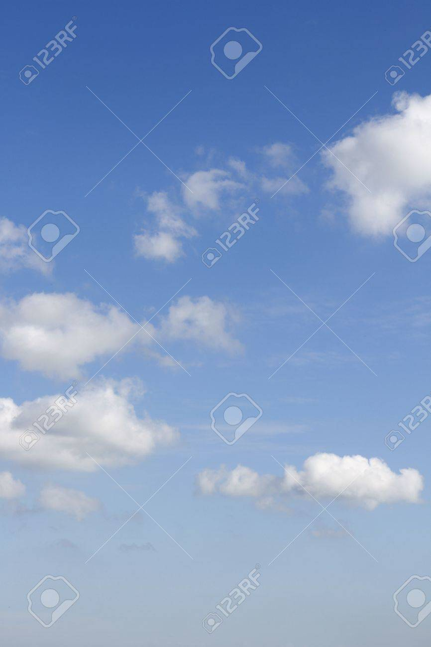 Fluffy clouds in a blue sky Stock Photo - 19744368