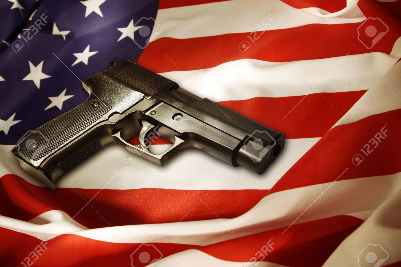 Handgun lying on American flag - 26540666