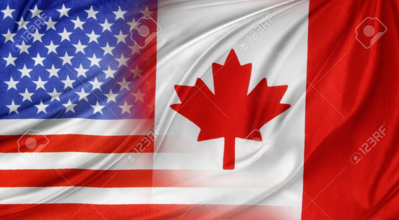 american and canadian flags together stock photo picture and