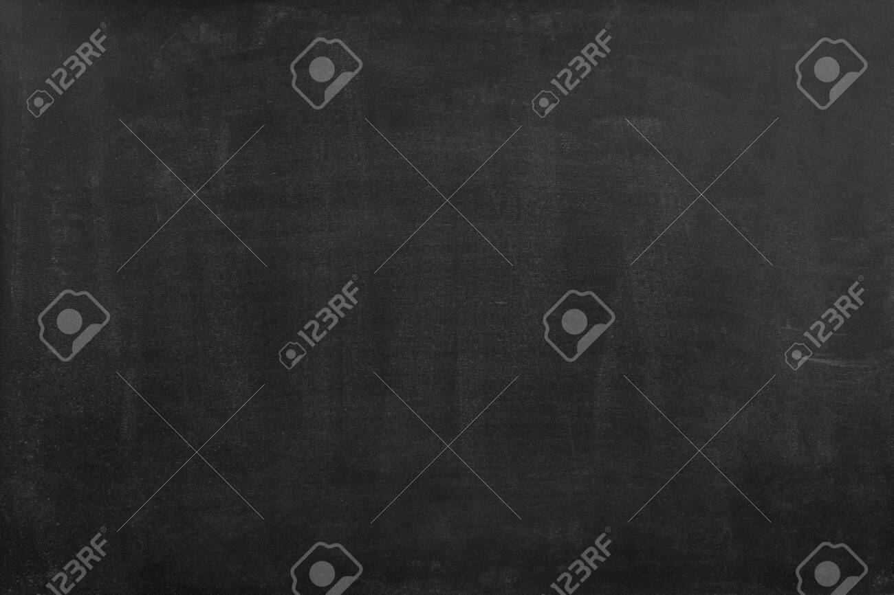 Chalk rubbed out on blackboard background - 129708996