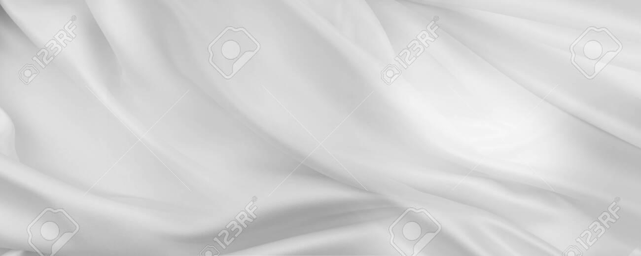 Closeup of rippled white silk fabric lines - 140937393