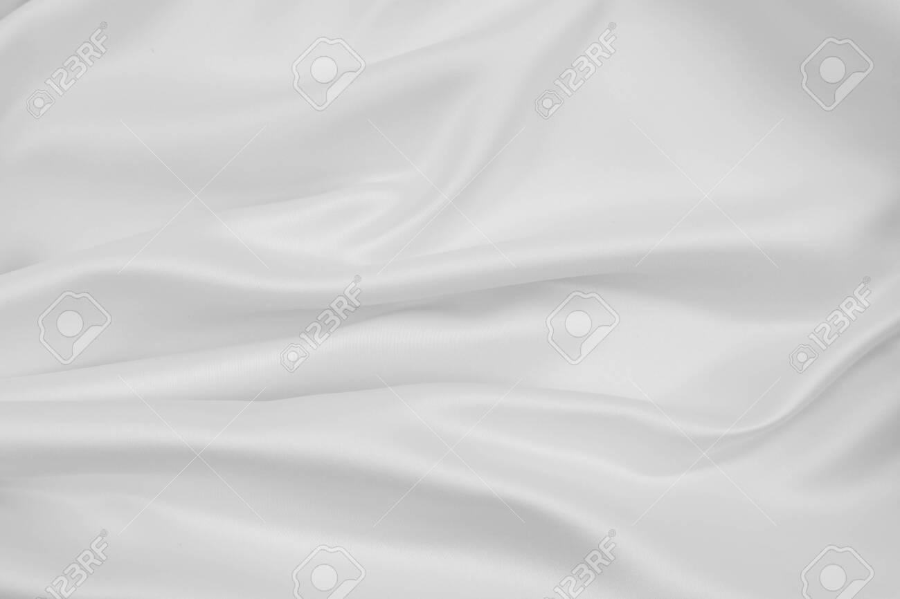 Closeup of rippled white silk fabric lines - 145107673