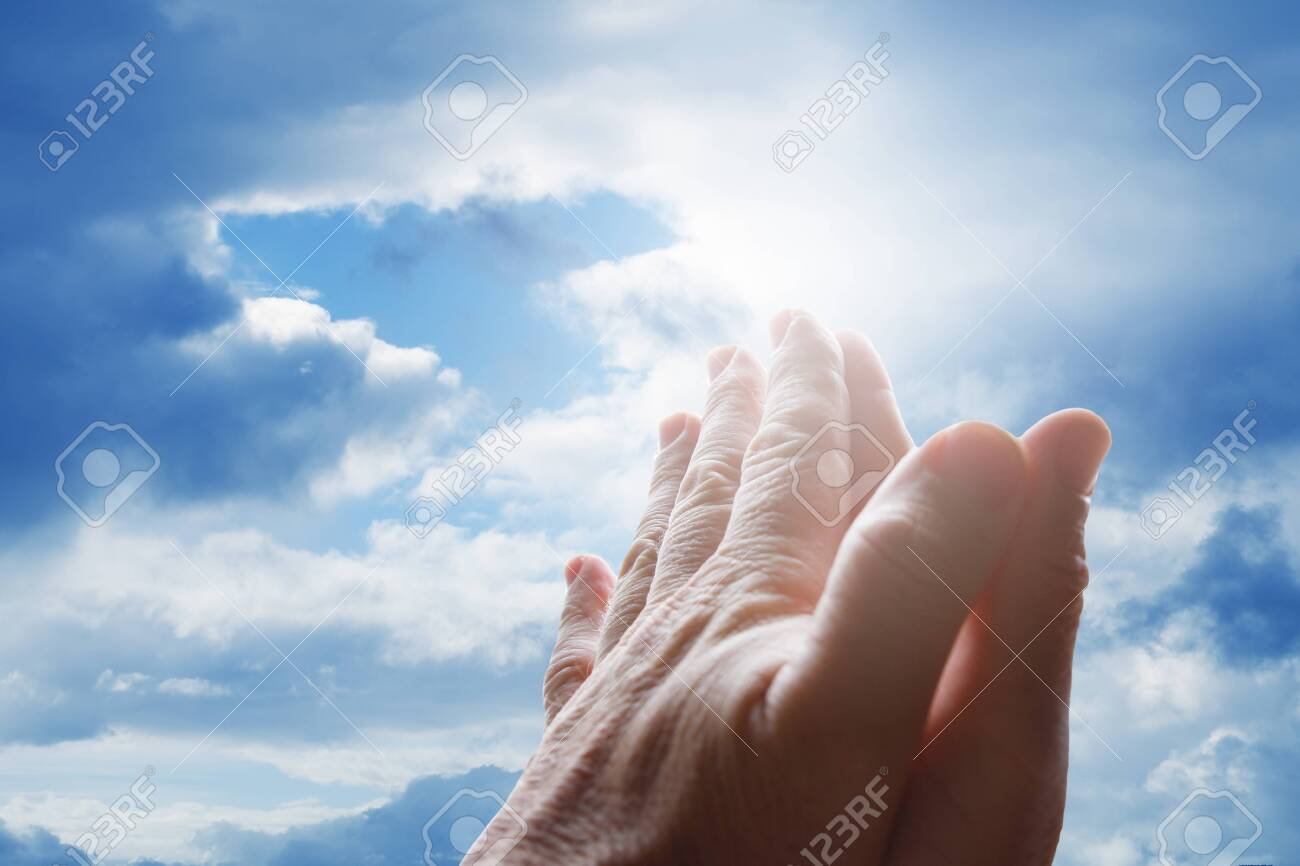 Hands praying in the sky - 156119128