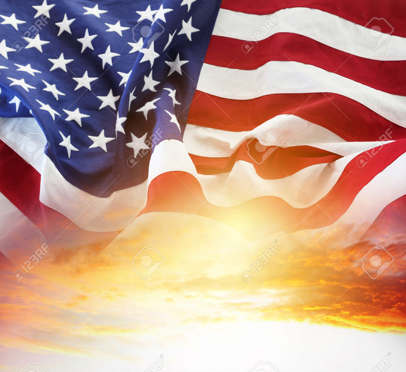 American flag in sunny sky - 166694366