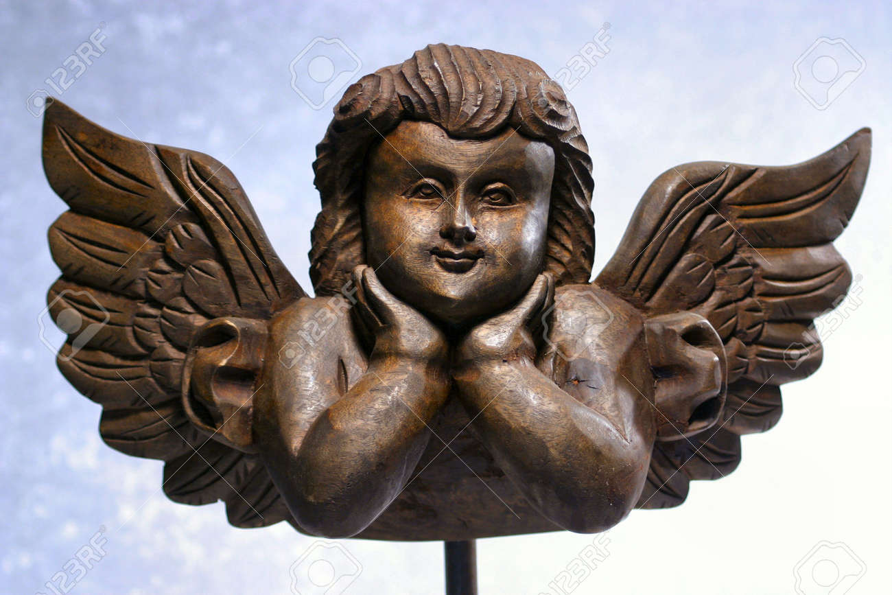 A Hand Carved Wooden Angel