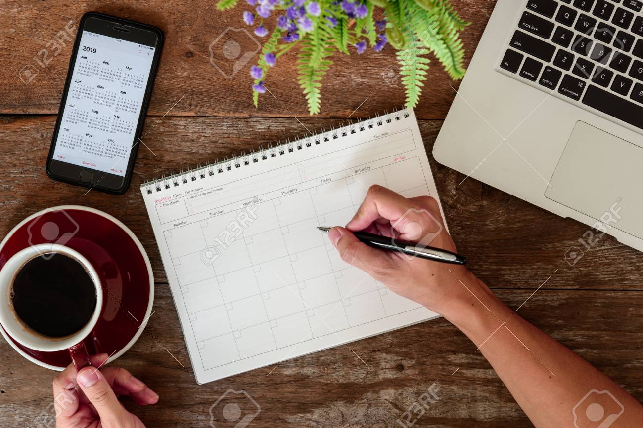 SEPTEMBER 17, 2018: Working table top with organizer for monthly planing with Iphone 8 plus use calendar application with year 2019 - 113347750