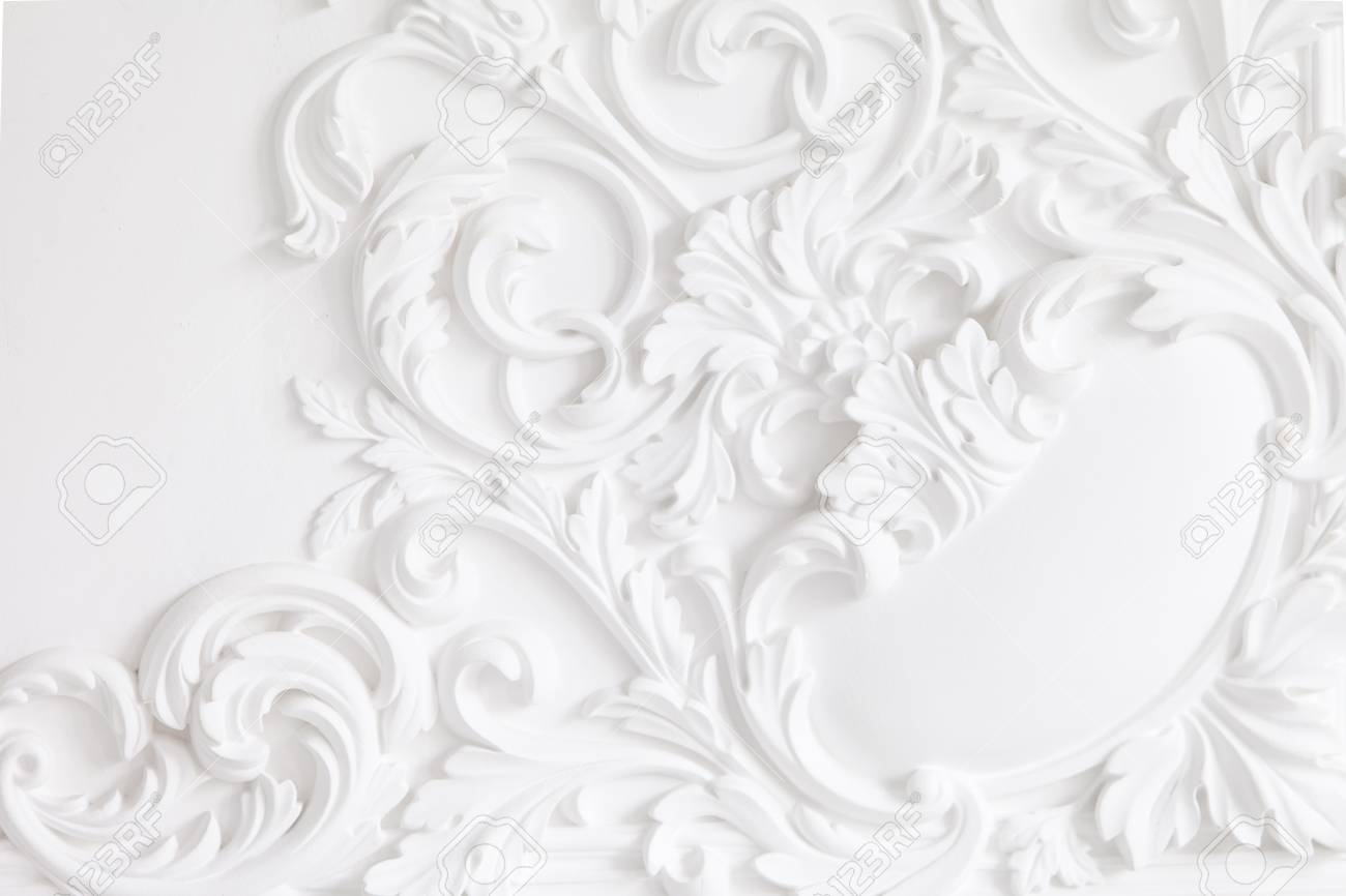 Beautiful ornate white decorative plaster mouldings in studio
