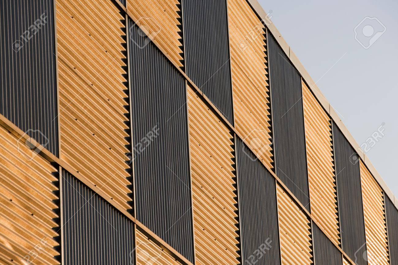 Corrugated Metal Walls corrugated metal wall pannels reflecting the sunset stock photo