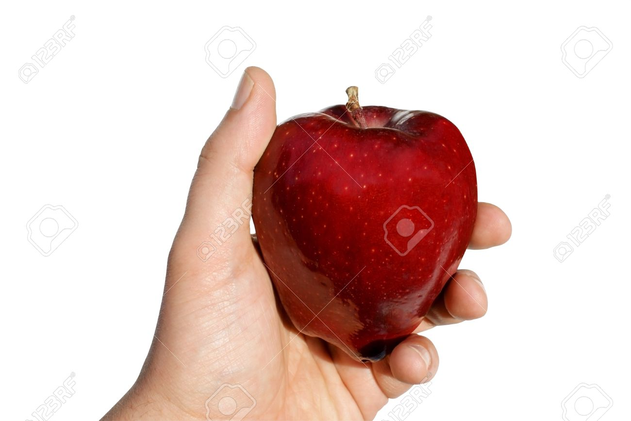 View of an apple in hand against white background. Stock Photo - 8952156