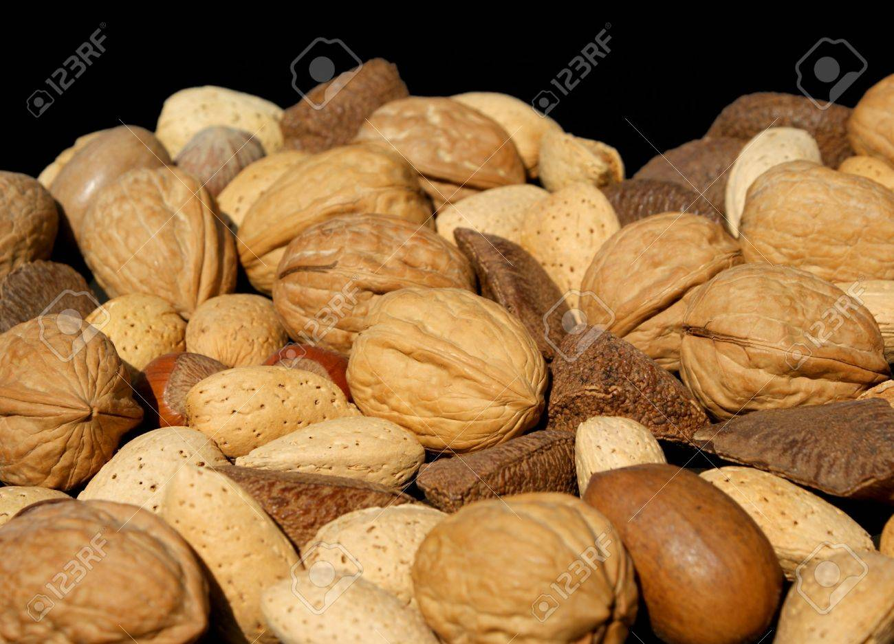 Angled view of assorted nuts against black background. Stock Photo - 8952163