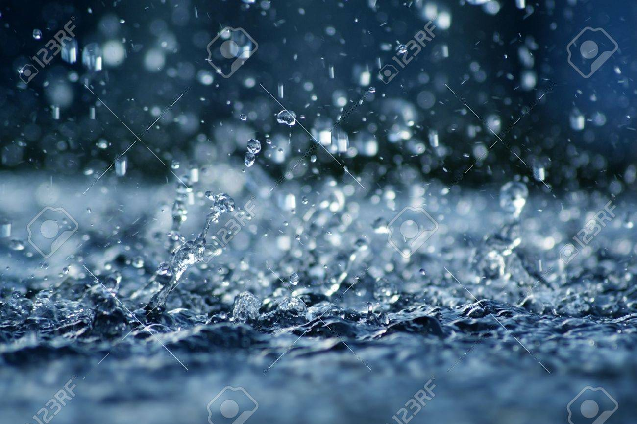 View of falling rain cast in a blue light. Stock Photo - 10775823