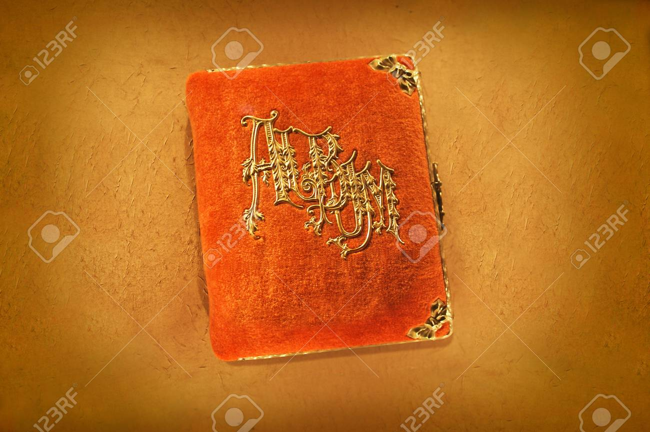 Antique orange photo album from the early part of the 20th century. Stock Photo - 34726569