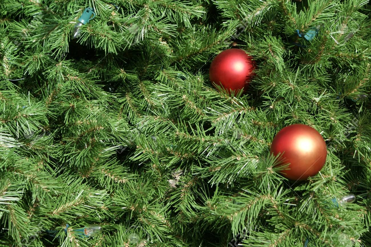 Closeup view of a Christmas tree with ornaments and lights. Ideal for use as a background. Stock Photo - 34726323