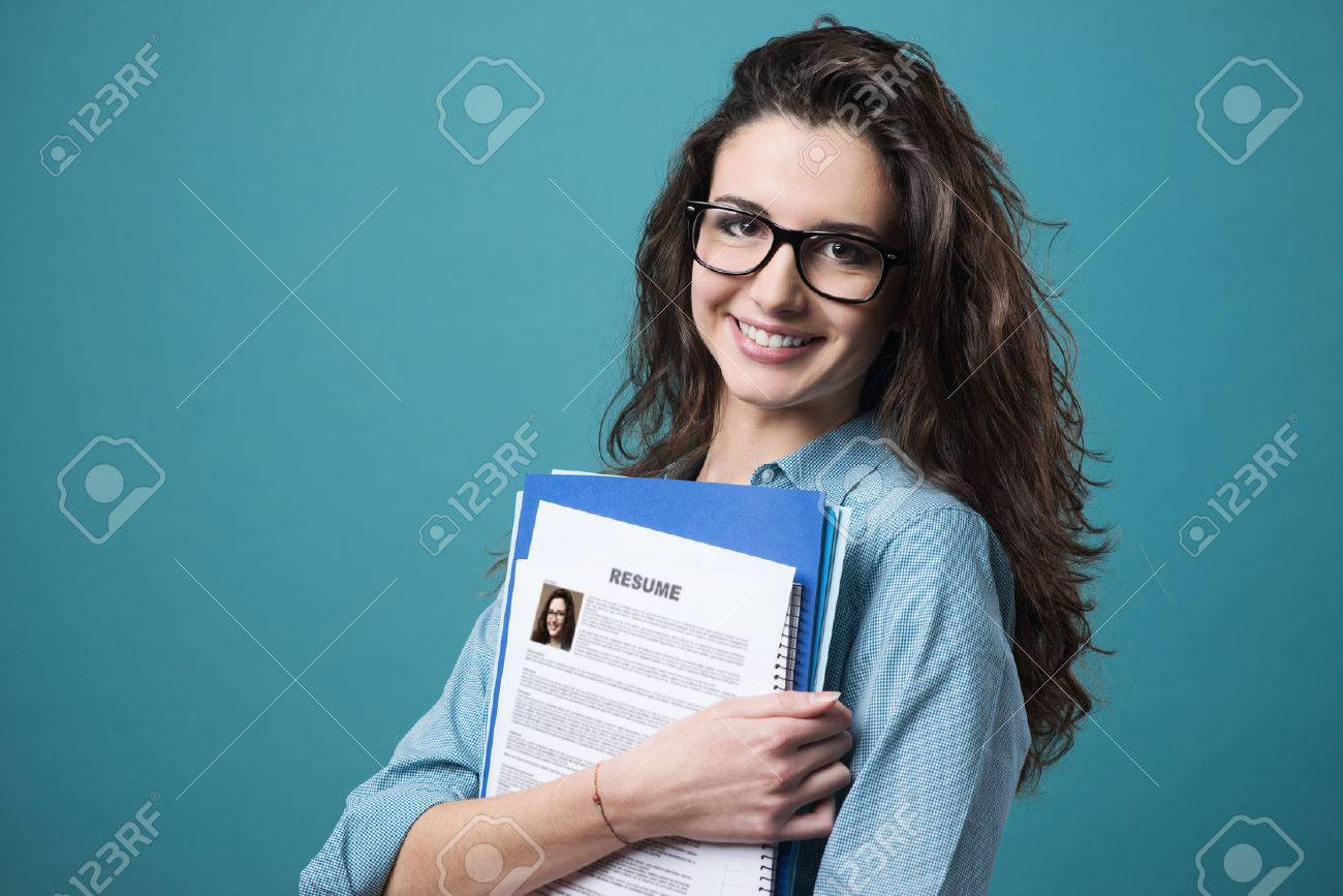 resume Resume Girl young smiling cheerful woman holding her resume stock photo picture resume