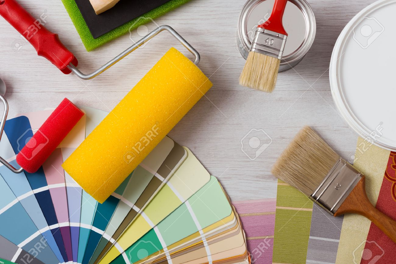 decorator painter and decorator work table with house project color swatches painting roller - Decorator
